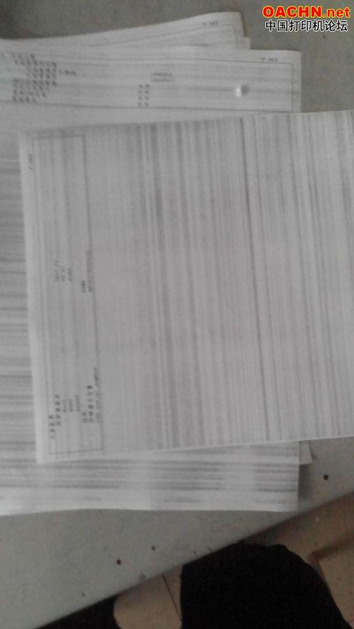 佳能2420l更换定影膜后整张纸出黑道